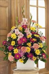 Spring Colors in Funeral Basket by Arrington Flowers, Your Rocky Mount, VA Florist